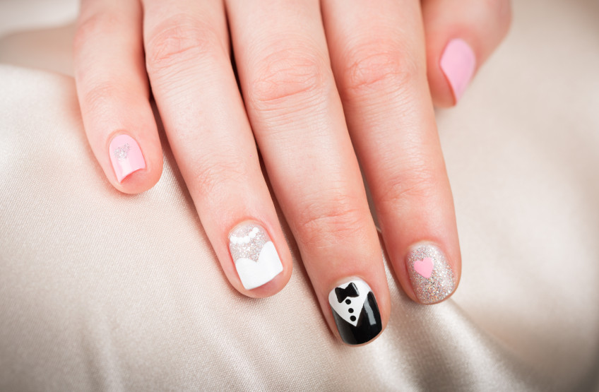 Your manicure can match the wedding theme or the veil design
