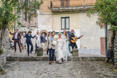 Picture with a group of people celebrating with songs for the oudoor wedding